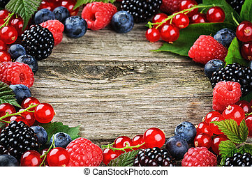 Summer frame with fresh colorful berries