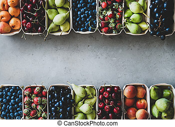 Summer fruit and berry assortment in wooden boxes, copy space
