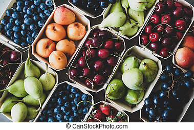 Summer fruit and berry assortment in wooden eco-friendly boxes