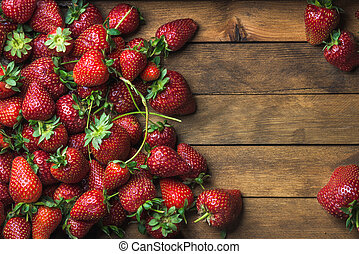 Strawberries over natural wooden background - Summer fruit ...