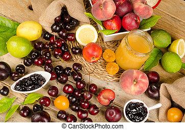 Full frame take of seasonal summer fruit on a wooden table
