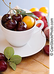 Summer fruits and berries in a cup
