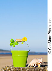 Enjoying the fun of summer holidays at the beach near the ocean. With room for your text.