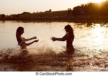 summer fun: filtered image of 2 beautiful young woman or teenage