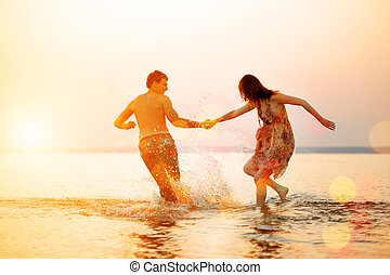 Summer fun holyday on beach background. Couple in love in beach party. Summer scene about sunset sky.