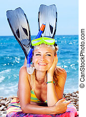 Beautiful woman having outdoor fun, female on the beach, happy teen girl wearing mask and fins, water sport, healthy young lady tanning and sunbathing, summer vacation, holidays travel