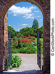 A Summer Garden through an archway in a Stately Home in Devon