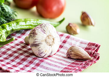 Summer gifts fresh Garlic, red tomatoes, green dill, onion on the kitchen table. The healthy food