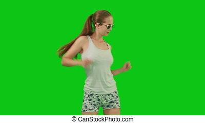 Summer girl in sunglasses dancing