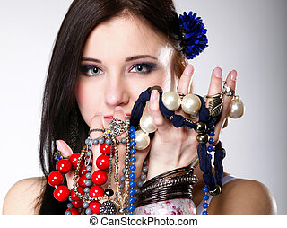 summer girl plenty of jewellery beads in hands - young woman...