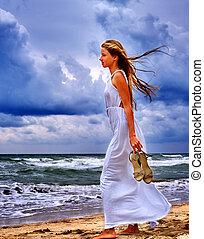 Girl walk on beach sea.