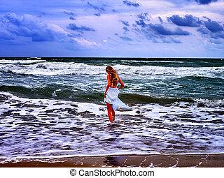 Summer girl sea walk on water beach.