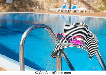 Summer hat at the swimming pool
