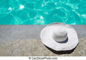 Summer hat near the pool