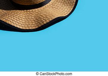 Summer hat on blue background.