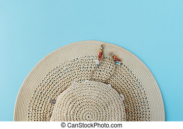 Summer hat top view on blue background