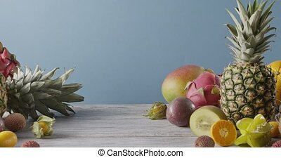 Summer healthy exotic passion fruits, pine apples and dragon...