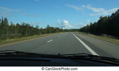 Driving on the interstate highway. Heading towards Bangor, Maine, USA.