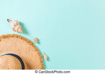 summer holiday beach background with accessories on blue table, top view with copy space. vacation concept