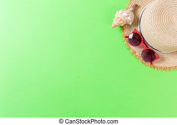 summer holiday beach background with accessories on green table, top view with copy space. vacation concept