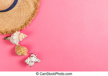 summer holiday beach background with accessories on pink table, top view with copy space. vacation concept