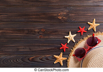 summer holiday beach background with accessories on wooden table, top view with copy space. vacation concept