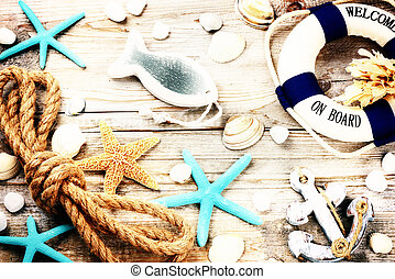 Summer holiday frame with seashells and beach accessories
