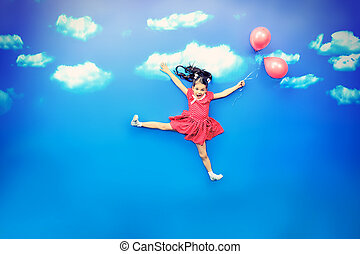 summer holiday - Happy little girl flying on balloons in a ...