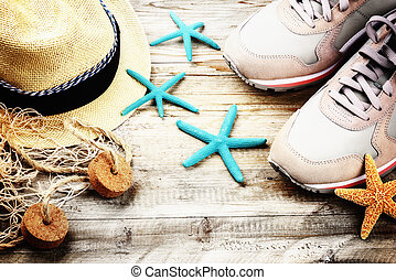 Summer holiday setting with straw hat and seashells