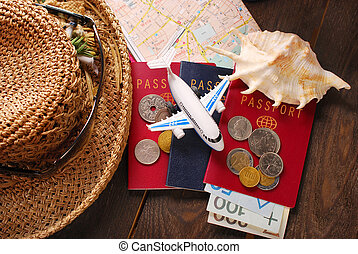 summer holiday traveling concept with passports, money, maps...