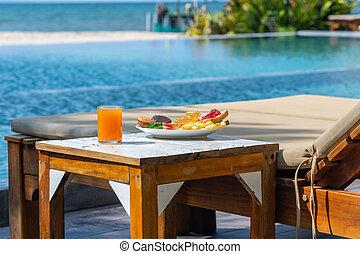 Summer holiday vacation at swimming pool resort