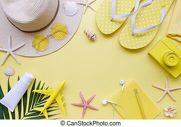 Summer holiday Vacation border frame mockup. Top view beach accessories on a yellow background. Copy space