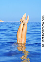 summer holiday vacation, woman diving in sea