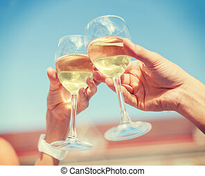 couple drinking wine in cafe - summer holidays and dating...