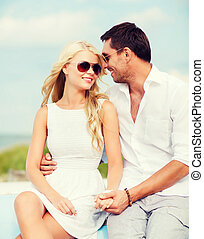 couple in shades at seaside - summer holidays and dating...