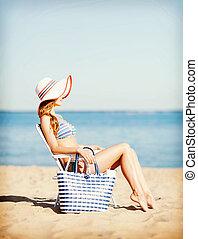 girl sunbathing on the beach chair - summer holidays and ...