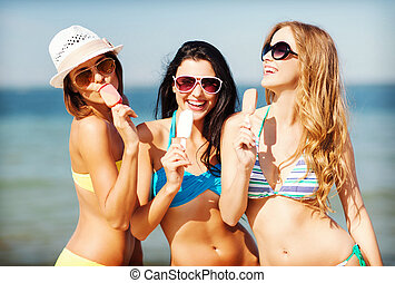 girls in bikini with ice cream on the beach - summer ...