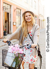 attractive woman in hat with bicycle in the city