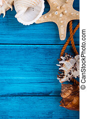Summer holidays blue background with space for advertising and maritime theme (seashells, starfish, sea knots, anchor, bow tie)