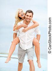couple at seaside - summer holidays, celebration and dating...