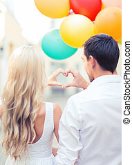 couple with colorful balloons