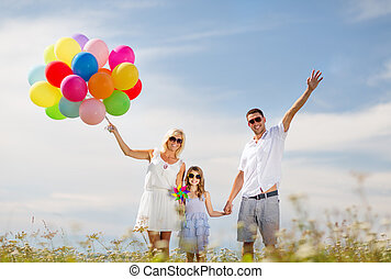 family with colorful balloons - summer holidays, celebration...