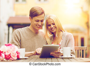 couple with tablet pc in cafe