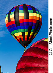 Summer Hot Air Balloon Festival - Brightly colored hot air...