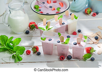 Summer ice cream with fruits and mint leaf