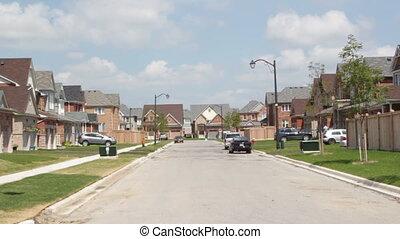 Summer in suburbia. - New suburban housing development....