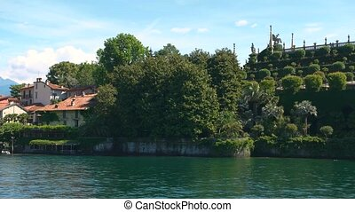 Summer, Isola Bella. Water, trees and buildings. Exclusive...