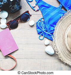 Summer items for women, beach summer collection on wood background