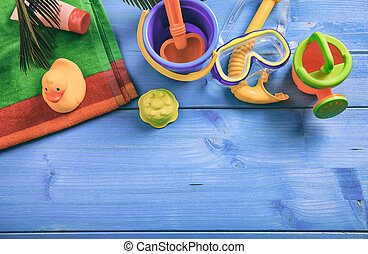 Summer kids vacation concept on blue background - top view