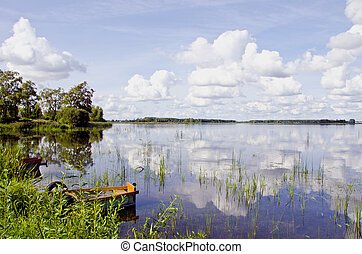 Summer lake landscape boats clouds reflections